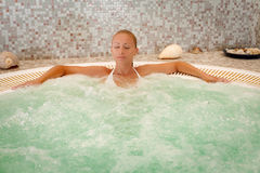 Girl In The Spa. Beautiful woman enjoying and relaxing in Jacuzzi at the spa center stock images