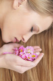 GIRL IN SPA WITH FLOWER Stock Images