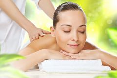Girl at spa massage Stock Images