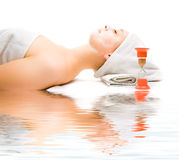 Girl at spa procedures Stock Images