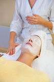 Girl in spa salon royalty free stock images