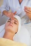 Girl in spa salon stock image