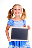 Girl with space width showing a little blackboard Royalty Free Stock Photos