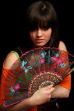 Girl with a spanish fan Stock Image