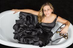 Girl with spanish flamenco dress in a bathtub Royalty Free Stock Photo