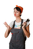 Girl with spanner looking at nails Royalty Free Stock Photography