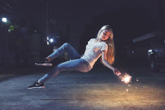 Girl with sparkler in air