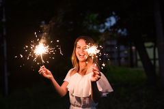 Girl with sparkler Stock Images