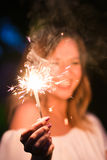 Girl with sparkler Stock Photography