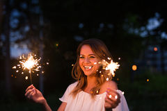 Girl with sparkler. In the autumn field Royalty Free Stock Photos