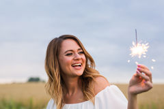Girl with sparkler Stock Image