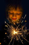 Girl with a sparkler Stock Photos