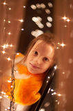 Girl and sparkling lights Royalty Free Stock Photos