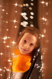 Girl and sparkling lights Royalty Free Stock Photography