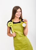 Girl with a spatula and a clock Stock Image