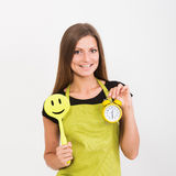 Girl with a spatula and a clock Stock Photography