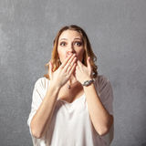 Girl in speak no evil pose Royalty Free Stock Images