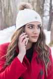 Girl speak on phone in winter ambient stock photo