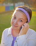 Girl Speaking On Cell Phone. At Sunset Royalty Free Stock Photos
