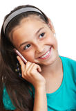The girl is speaking by phone. The happy and smiling girl is speaking by phone Stock Photos