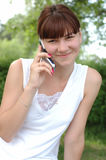 Girl speaking on phone. Smiling young female speaking on mobile phone Stock Image