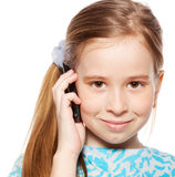 Girl, speaking on the phone. Child talking on mobile phone isolated on white backgraund Royalty Free Stock Images