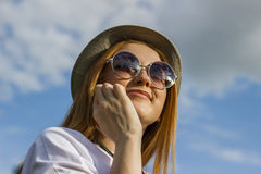 Girl speaking on the phone. Happy girl speaking in the phone Royalty Free Stock Photo