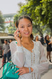 The girl speaking by phone Stock Image