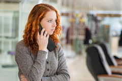 Girl speaking by the phone. Stock Photo