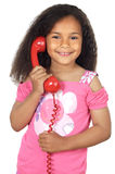 Girl speaking on the telephone. Adorable girl speaking on the telephone a over white background Royalty Free Stock Image