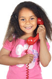 Girl speaking on the telephone. Adorable girl speaking on the telephone a over white background Royalty Free Stock Photo