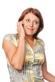 Girl speaks by a mobile phone Royalty Free Stock Photos