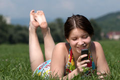 Girl speaks by mobile phone Stock Images