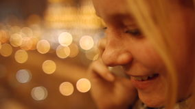 The girl speaks on a mobile phone close-up. 4K 30fps ProRes stock video footage