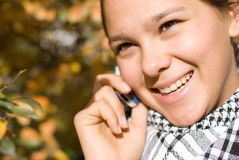 Girl speaks by phone Stock Images
