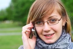 The girl speaks by phone Royalty Free Stock Photo