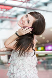 Girl speaks by phone Royalty Free Stock Photos