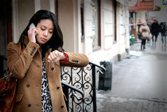 Girl speaks by phone Royalty Free Stock Photography
