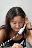 Girl speaks by phone. The girl speaks by phone at office Royalty Free Stock Photo