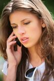 Girl speaks on phone Stock Images