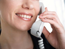 The girl speaks on the phone Royalty Free Stock Image