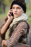The girl speaks by phone in the autumn Royalty Free Stock Images
