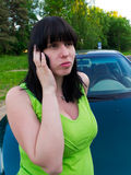The girl speaks by phone about car Stock Photo