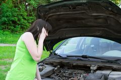 The girl speaks by phone about a car Stock Photography