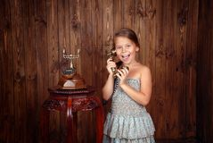Girl speaks by retro phone Royalty Free Stock Photography