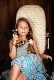 Girl speaks by retro phone Stock Photography