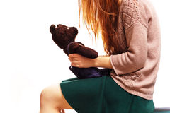 Girl speaks with teddybear. Psychological problems with communication with people Royalty Free Stock Photography