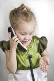 Girl speaks on the telephone. Stock Photography