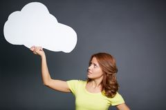 Girl with speech bubble. Portrait of young woman holding paper speech bubble and looking at it Stock Photos