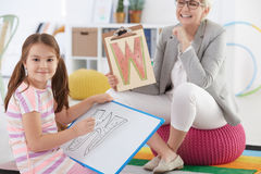 Girl with speech disorder Royalty Free Stock Images